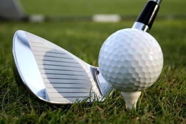 9 iron golf shot on a tee